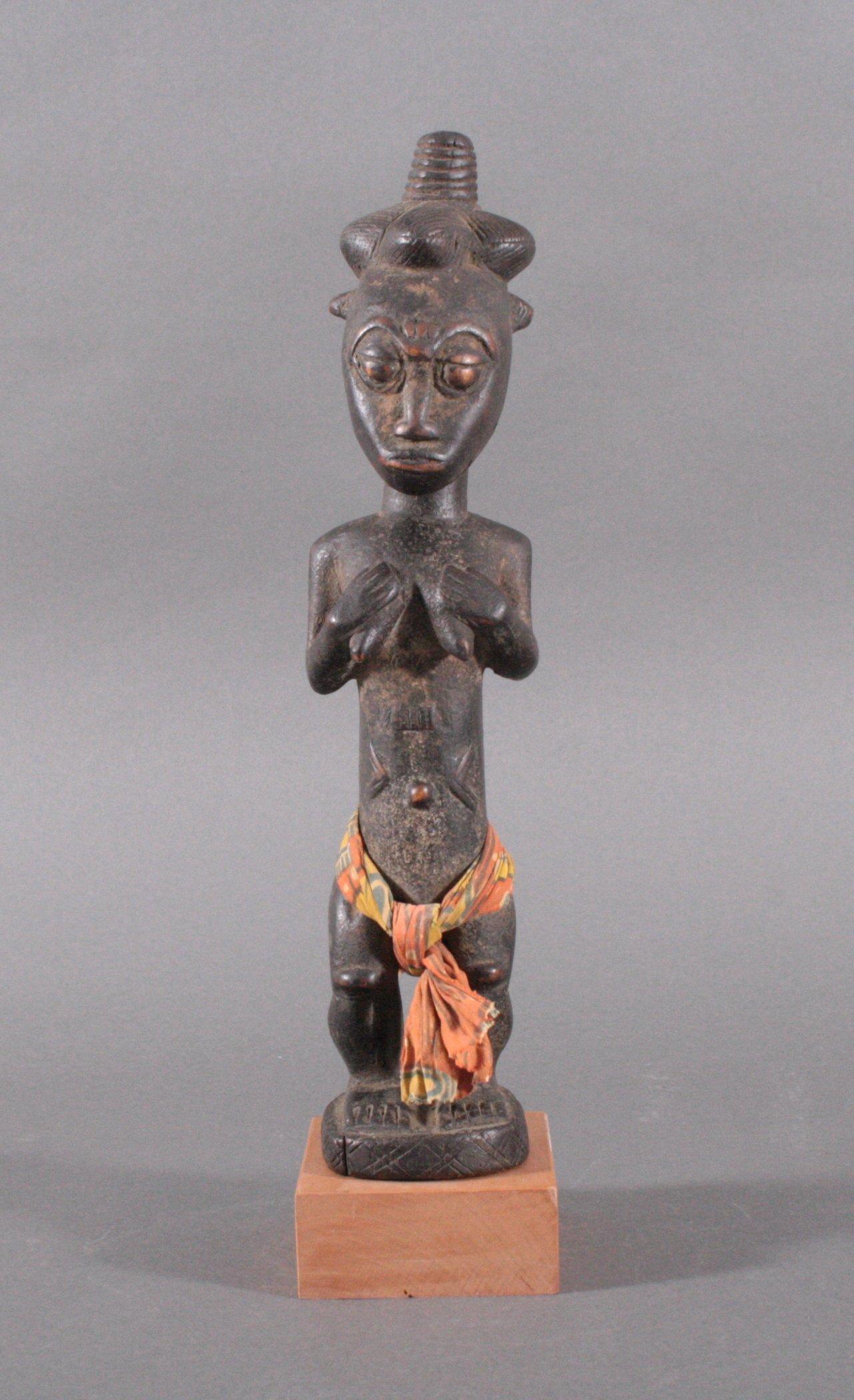 Weibliche hölzerne Figur, Afrika 1. Hälfte 20. Jh.