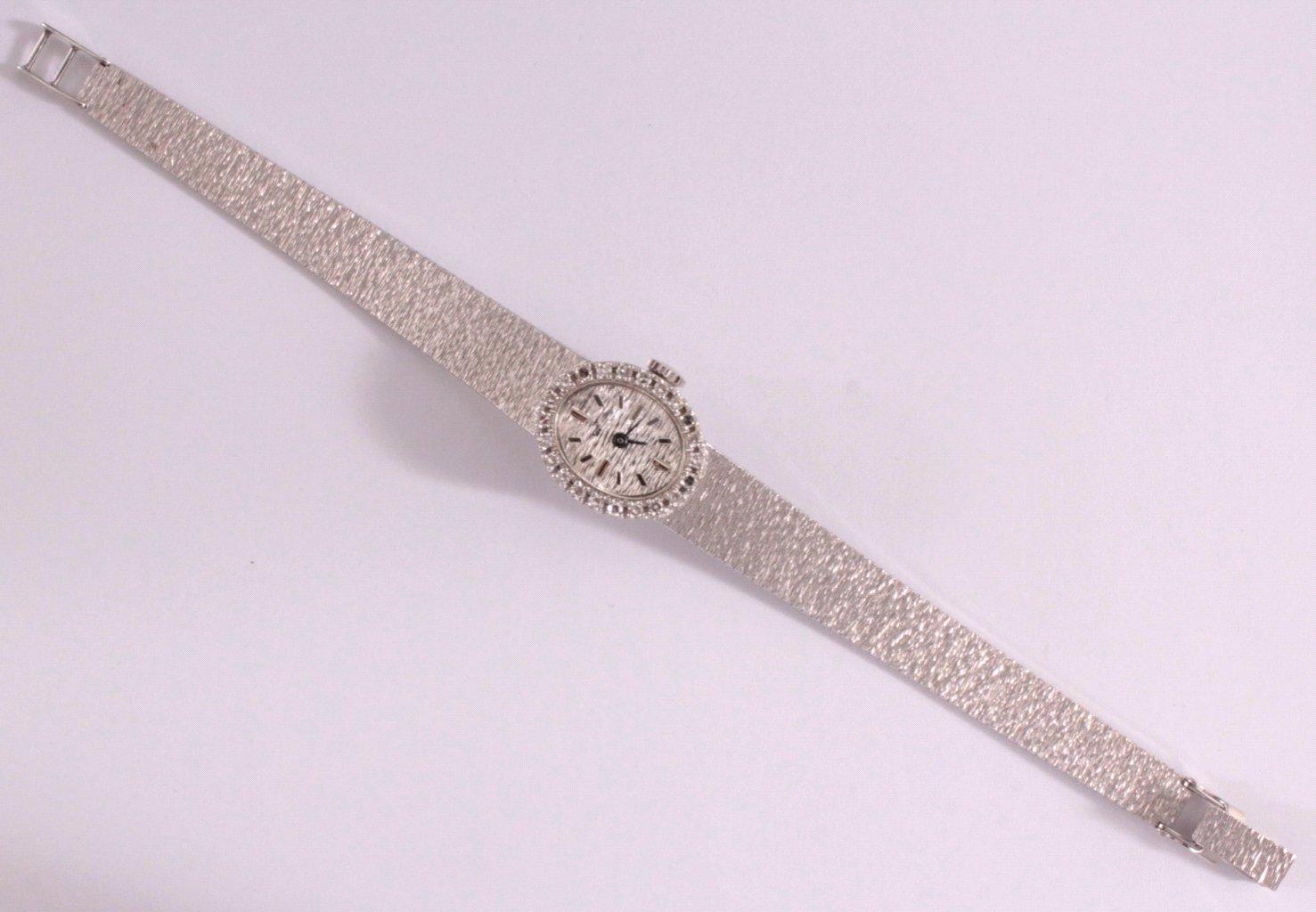Damenarmbanduhr mit Diamantkranz, 18 Karat Weißgold