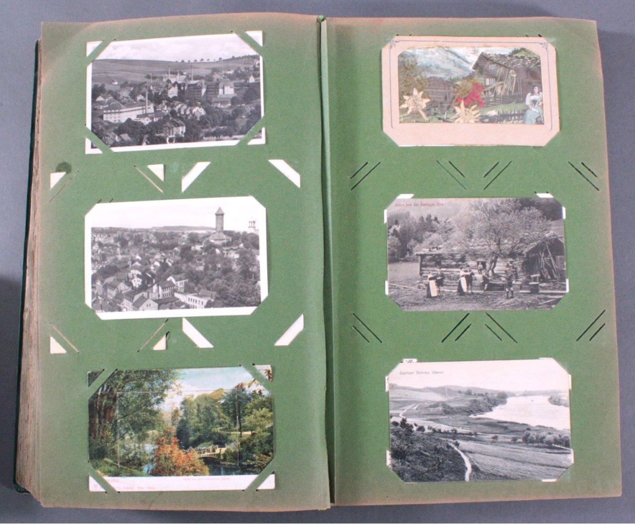 Prall gefülltes Album mit ca. 390 Postkarten-9