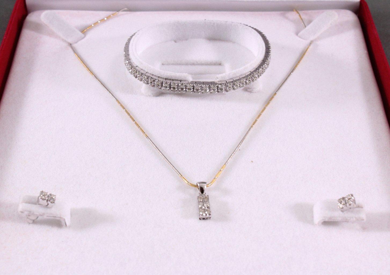 Schmuckset aus 750 Weiß- und Gelbgold mit Diamanten