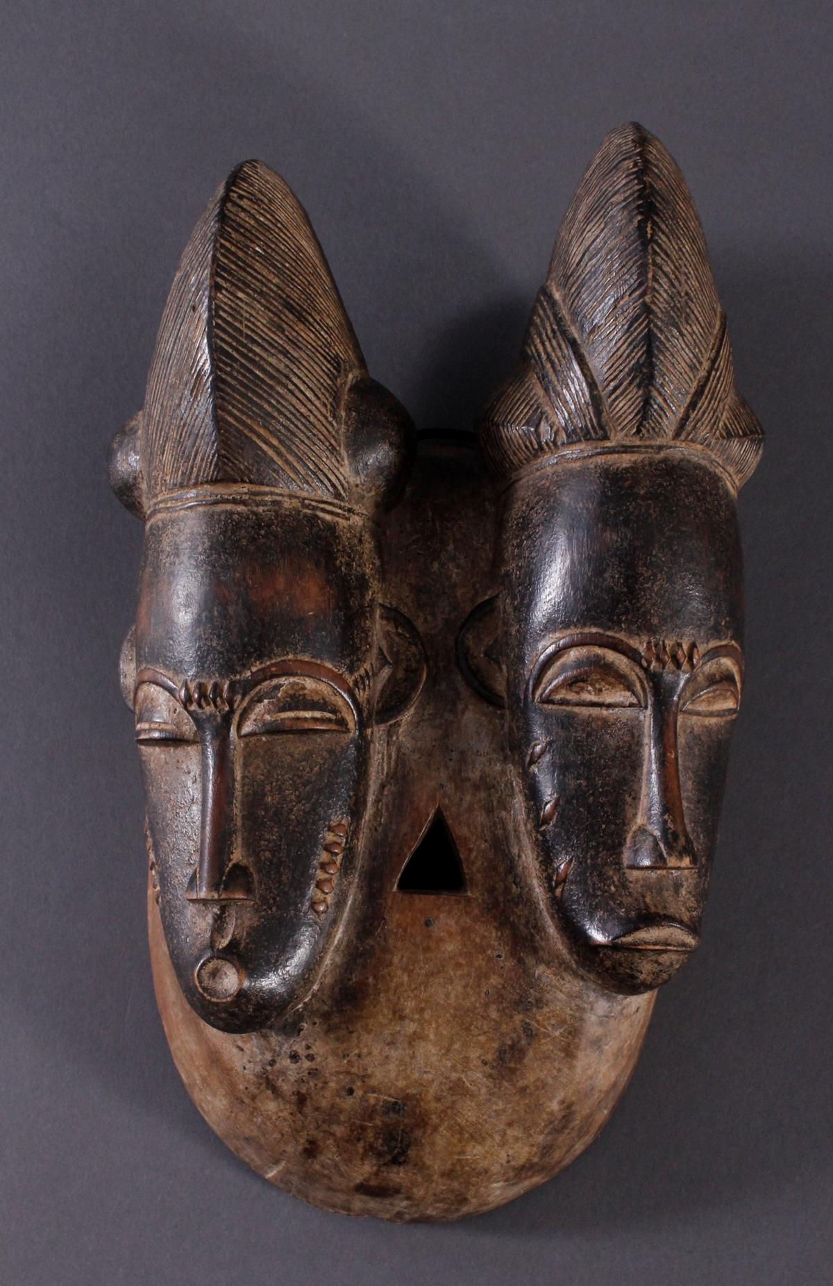 Antike Zwillingsmaske der Baule, Elfenbeinküste, 1. Hälfte 20. Jh.