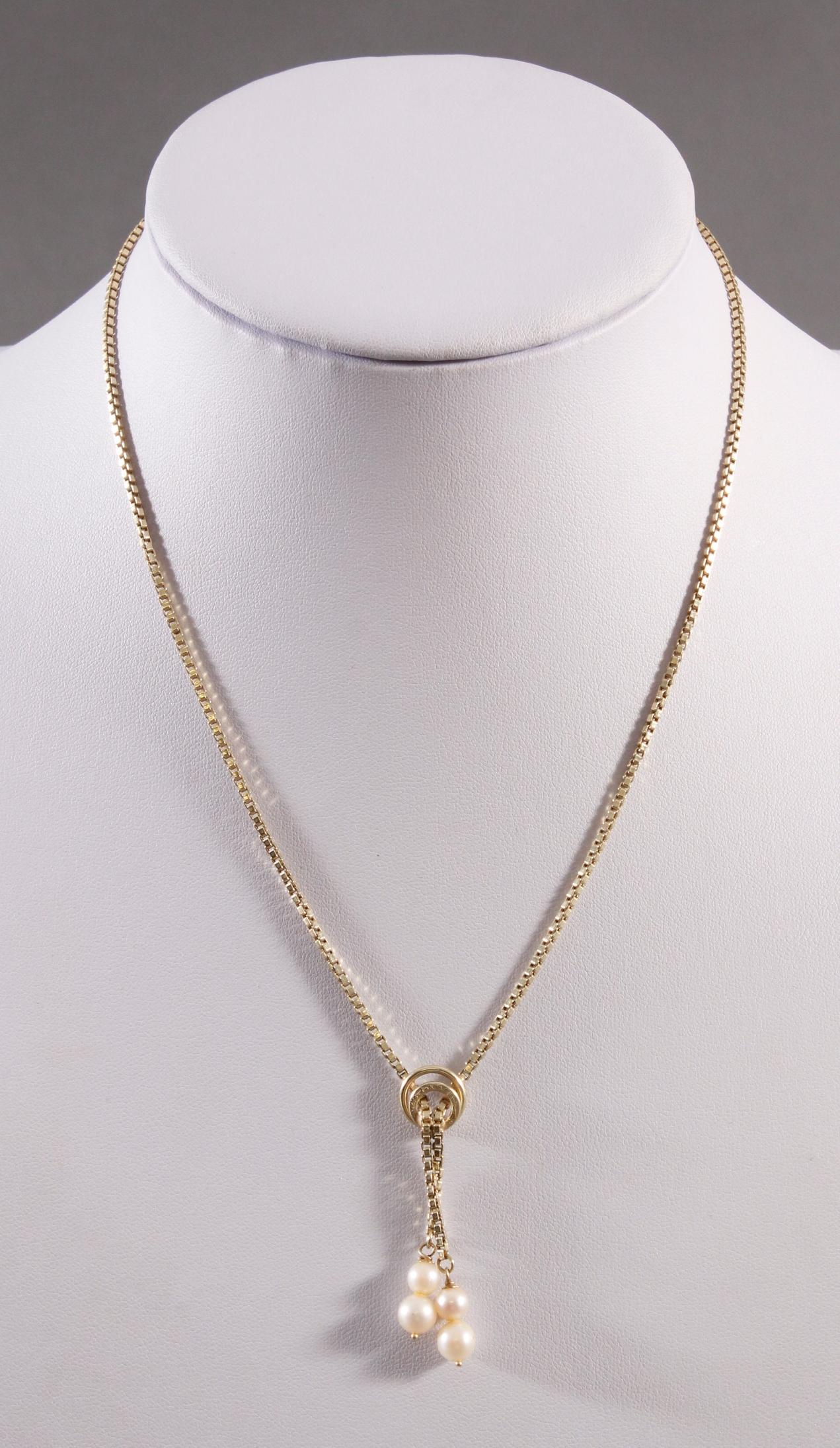 Collier mit Perlen aus 14 Karat Gelbgold