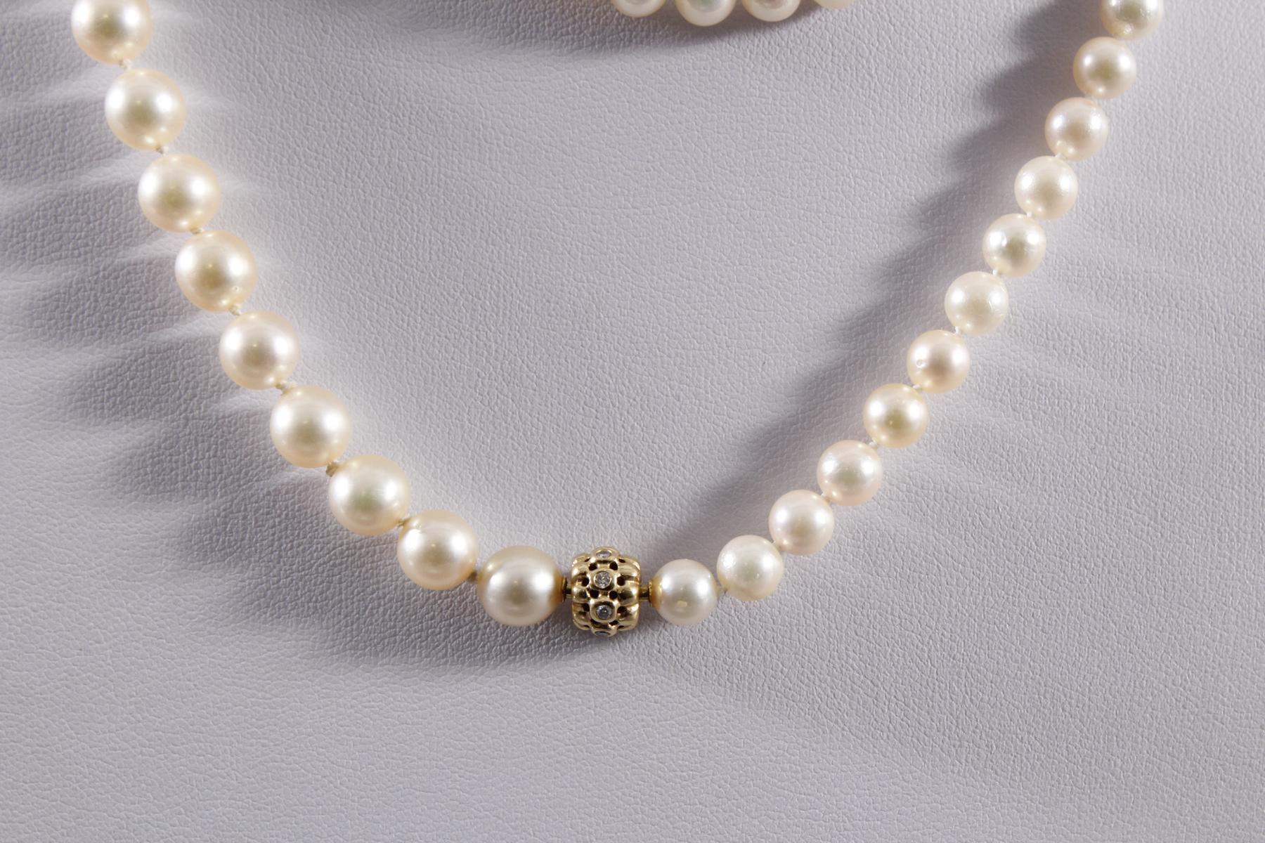 Halskette aus Perlen und Diamanten-2