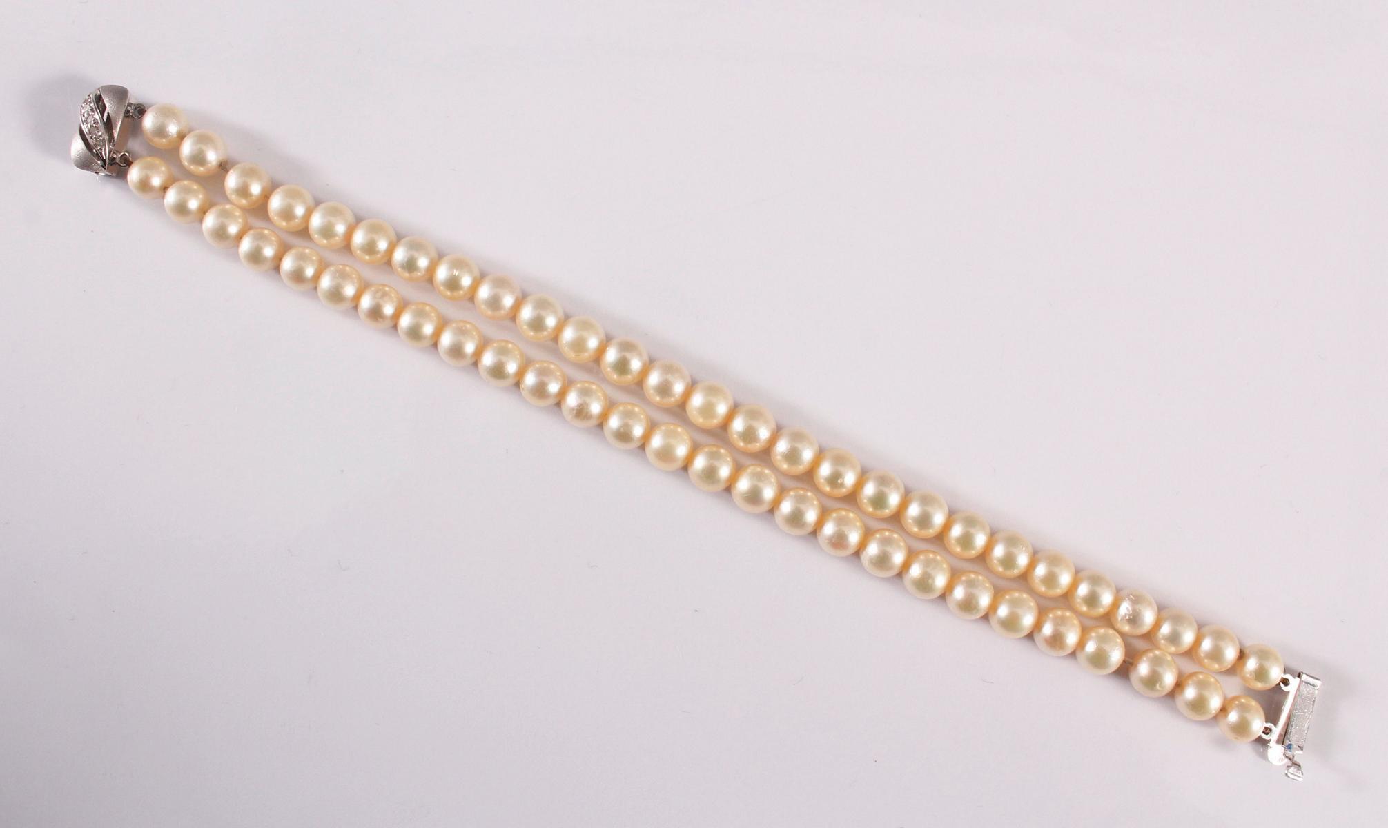Perlenarmband mit 14 kt Weißgoldschließe und Diamanten-2