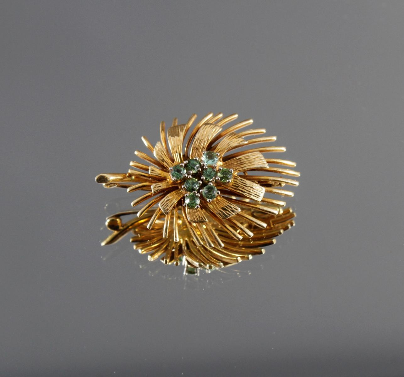 Brosche mit Peridot im Diamantschliff, 14 kt Gelbgold