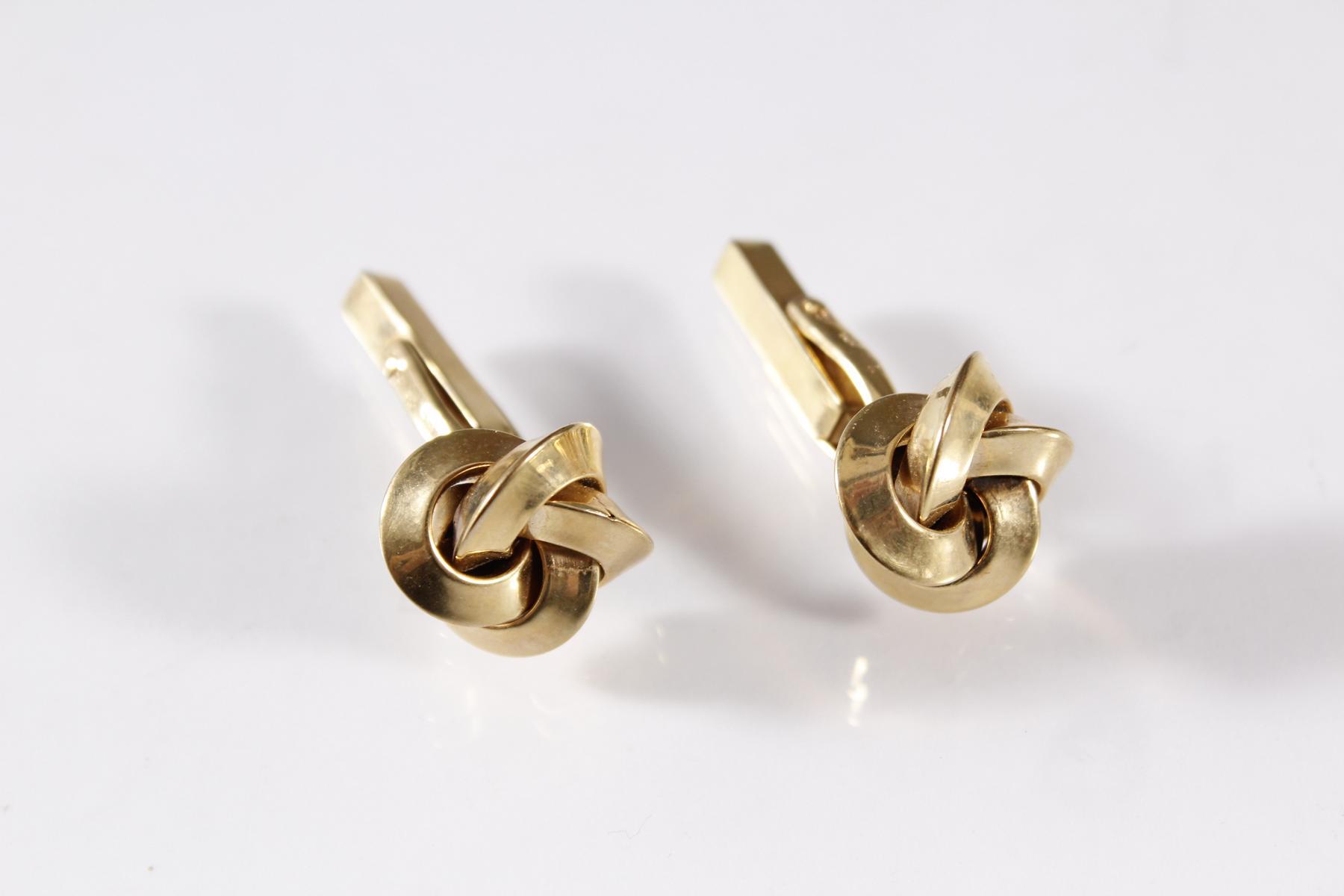 Paar Manschettenknöpfe, 8 Karat Gelbgold